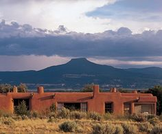 """""""As soon as I saw it, I knew I must have it,"""" said Georgia O'Keeffe of the simple adobe house at Ghost Ranch, her first residence in her beloved New Mexico. New Mexico Usa, Travel New Mexico, New Mexico Style, Abiquiu New Mexico, Sante Fe New Mexico, Georgia O Keeffe, Wisconsin, Riad, Adobe House"""