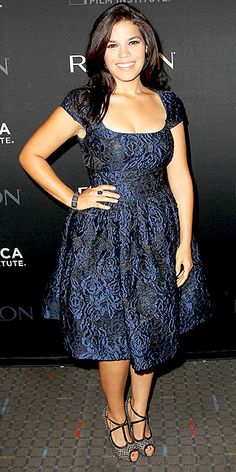 In a romantic, retro navy brocade dress with cap sleeves and a full skirt, accessorized with textured heels and Lorraine Schwartz gems, actress America Ferreira is pure elegance at the N.Y.C. Half the Sky screening.