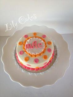 Pretty pink and orange polka dots with monogram smash cake