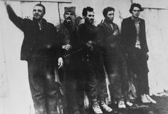 Five Serbian partisans just prior to their execution by a German army firing squad. According to the Muzej Revolucije Narodnosti Jugoslavije, the men being executed are members of the regional committee of the Communist Party. 1941.