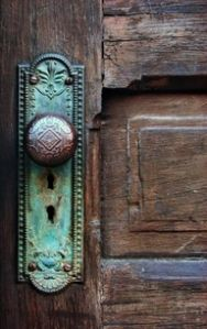 Rustic door- love the touch of greenish-turquoise