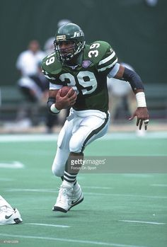 Johnny Johnson of the New York Jets carries the ball against the Indianapolis Colts during an NFL football game October 1994 at The Meadowlands in East Rutherford, New Jersey. Johnson played for. Get premium, high resolution news photos at Getty Images Nfl Football Helmets, Nfl Football Games, Football Memes, School Football, Sports Games, Football Players, New York Jets Football, Jet Fan, American Football