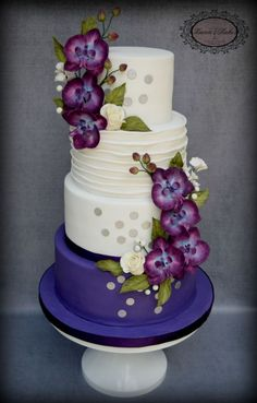Plum and white wedding cake with orchids and white roses by Karen's kakes