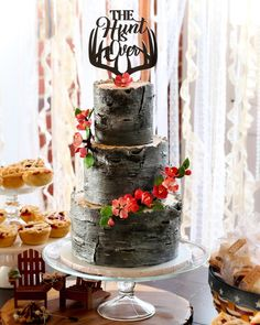 All American Bark-Inspired Wedding Cake with Antler Cake Topper and Sugar Cherry Blossoms
