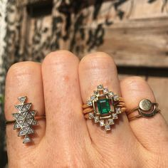 Columbian emerald ring with diamond stackers either side and our favourite cosmic Union ring on the pointer finger - for enquiries emails us on weddings@ZoeAndMorgan.com
