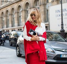 Womenswear Street Style by Ángel Robles. Fashion Photography from Paris Fashion Week. Woman on the street wearing a red vest with red midi skirt and white tshirt.