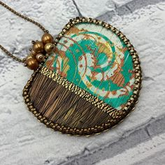 Bronze and green mixed media polymer clay focal with bead embroidery finish. Hung from a simple bronze ball chain and featuring a flourish of Swarovksi pearls this piece shouts 'Springtime!'. Polymer clay focal by Jenny Church Studios beaded by On A String. Now available in store. Free delivery to Australia and the United States.  . . .   #makerscollectiveaustralia #makersgonnamake #makersmovement #supportlocal #supportlocalau #shoplocal #melbournelocal #melbournemarkets #melbournedesign…