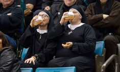 Two women wearing nun outfits drink beer while watching the 2014 Tim Hortons Brier curling championships in Kamloops, British Columbia in this March 8, 2014. Photo and caption by Ben Nelms/Reuters.