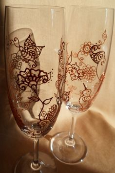 Wedding toasting flutes in copper (2). Hand painted mehndi style designs of hummingbird, butterfly and flowers. Personalize (option). Mehndi Glass via Etsy.