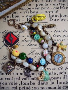 3 Strand Charm Bracelet with Frog  I'm a hoarder. There, I said it. I've got drawers and drawers filled with tiny things: beads, charms, glass cabochons, etc., etc. etc. I found this vintage plated disc chain and rifled through my stash to find things to glue to it. Turns out, that was not a problem!   I made 2 of these type earlier this year and they sold immediately. So, I made more of these 3 strand bracelets, all with vintage components!...