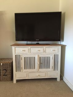 Balinese Buffet repurposed into a cute TV cabinet, finished in old white with clear wax and clear wax top.