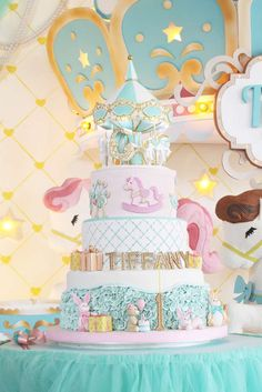 Stunning cake at a carousel birthday party! See more party planning ideas at CatchMyParty.com!