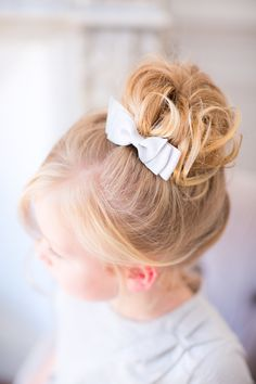 Pretty flower girl hair in a bun. Modern Beauties. Photography: Le Secret D'Audrey - lesecretdaudrey.com