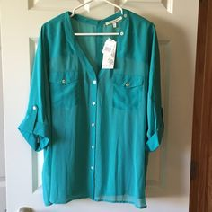 NWT! Gorgeous sheer top with tank top You to full sheer green top with tank top. I love this, but it is too small for me. Black rainn Tops Blouses