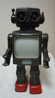 Japanese Toy Robot (tin body and plastic head) Battery operated but not working.