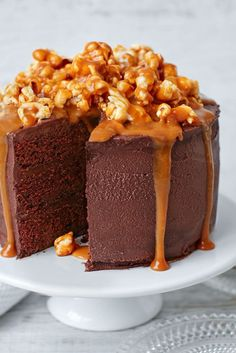 Celebrate in style with this showstopping chocolate, popcorn & salted caramel cake. You can find this cake recipes & more baking ideas at Tesco Real Food. Cake Recipes, Snack Recipes, Snacks, Chocolate Sponge, Chocolate Ganache, Salted Caramel Popcorn, Pop Corn, Tesco Real Food, Caking It Up