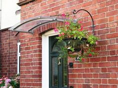 Arched glass canopy (awning).... Check out the awning we made ...