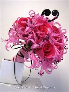 Unique and funky bouquet of roses, nerine lilies and fern curls