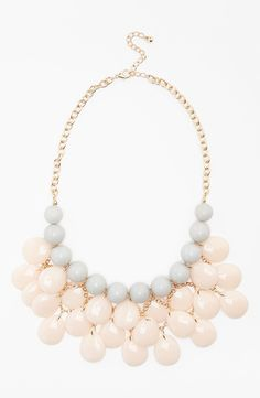 Loving the pale pink and grey beads on this pretty statement necklace.