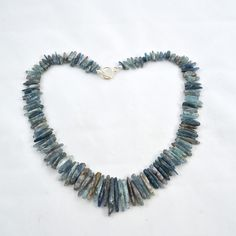 "Blue Kyanite Necklace. $32.00, via Etsy.    Kyanite is a semiprecious gemstone, which has a soft chatoyancy. This necklace measures about 19"" with graduated blades of Blue Kyanite and fastened with a silver-.plated toggle."