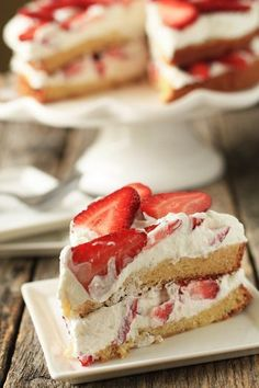 Strawberry Cream Cake | My Baking Addiction.  A moist, citrus infused cake topped with fresh whipped cream and strawberries