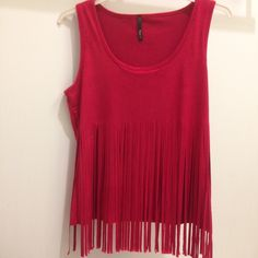 Sleeveless top with fringes in front. Medium size shown. Material is 93% polyester 7% spandex. It feels soft. Please note this top runs small especially in the bust. Will update with measurements. Tops