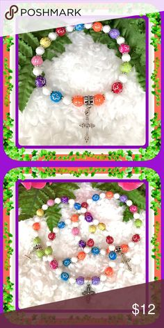 🌺🌴🌺 COLORFUL CROSS BRACELET 🌺🌴🌺 🌺🌴🌺 This original handcrafted bracelet has so many happy colors and had a cross on every other bead.  It also has a handing silver cross.  It was made using a secure stretch cord, which makes it easy on and off.  The colors lend themselves to so many clothing options.  The price for a separate bracelet is $12.00, but if purchasing all three the cost would be $12.00. That's getting one for free. LMK for a price adjustment. 🌺🌴🌺 Jewelry Bracelets