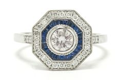 The Juneau Art Deco style diamond engagement with an exciting geometric design. The French cut sapphire halo surrounds a vibrant, shimmering bezel set diamond with a unique pinkish tone, embraced by finely detailed milgrain. You will love the low setting, perfect for daily wear that provides awesome finger coverage. #haloring #diamond #sapphire #bellarosagalleries #ido #love #halorings #targetring #targetrings #octagon #octogon #octagonring #octogonring #halorings #artdeco #artdecoring Estate Engagement Ring, Diamond Engagement Rings, Antique Engagement Rings, Art Deco Fashion, Halo, Art Deco Ring, Daily Wear, Blue Sapphire, White Gold