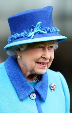 Queen Elizabeth II looks on at Ascot Racecourse on October 18, 2014 in Ascot, England.