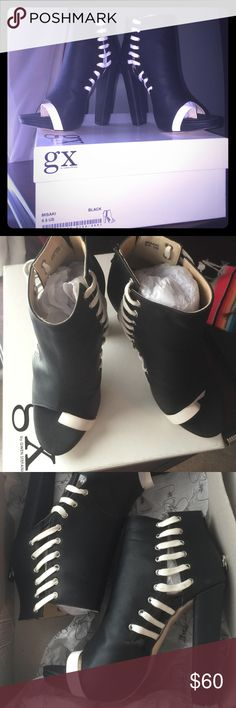 GX by Gwen Stefani booties BNWT  Misaki booties . Never worn . Still in original box . Have too many black heels . Very cute . Excellent condition ... Leather type Material .... Size 6 1/2 ... Great to wear with jeans GX by Gwen Stefani Shoes Heeled Boots