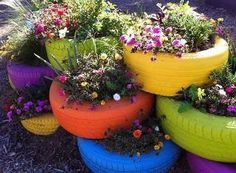 "Such a cute, clever flower garden! A perfect combo of oh-so-pretty and ""heck, yes, I live in Georgia. Of course I have tires in my yard."""