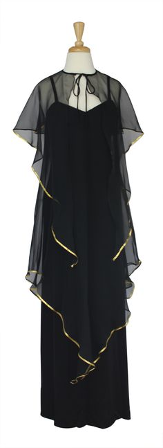 - A classic full length black jersey dress  - Spaghetti strapped shoulders  - Shallow V neckline  - A single layer of chiffon attached at the top of the bodice veils the dress with gold trim  - Skirt is a very gradual A-Line  - An additional, removable cape with gold trim ties at neck  - Hidden back zip closure