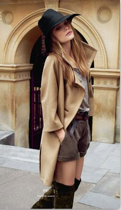 The hat gives the outfit a more relaxed attitude, the boots r super glam, the coat is classic and the shorts add a youthful air to it