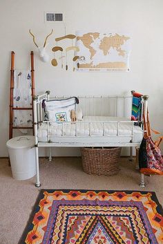 Love the eclectic feel of this nursery with the vintage touch of the old cot.