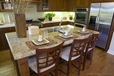 #Kitchen Idea of the Day: Medium-stained brown wood kitchen featuring an island and breakfast bar.