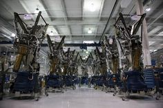 """Nine Merlin engines for the inaugural Falcon 9 flight, ready for integration onto the thrust structure.  <SpaceX, """"Merlin Rocket Engine"""" 2012. Hawthorne, California>"""