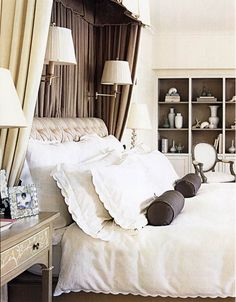 More formal than I prefer, but I like the concept of a shorter canopy to work around the ceiling fan above the foot of the bed.