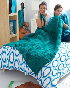 A garter stitch block pattern makes this blanket a stylish and cozy addition to dorm rooms and teens' rooms. Shown in Bernat Softee Chunky.