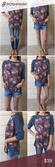 """▫️Vintage Floral Baseball Tee Perfect summer baseball tee! Floral with blue 3/4 sleeves. SO soft and very nicely made fabric. Slight dolman style arms. This is a live-in tee! Pair with any denim and shorts and you're set! Must-have! Modeling small. 63% polyester 34% rayon 3% spandex.  Made in USA. Measurements as follows: Bust: (S) 20"""" (M) 21.5"""" (L) 23"""" Length: (S) 28"""" (M) 28.5"""" (L) 29"""" *Bundle 2+ items for a discount. Tops"""