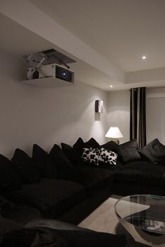 Stunning 'stealth' home theatre system using Meridian electronics and Artcoustic speakers. The system uses a motorised in-ceiling screen and projector lift to ensure a true cinematic experience when in use but minimum visual impact when switched off. Simple operation of the cinema system, blinds and lights is made possible by the custom programmed touchscreen remote control.