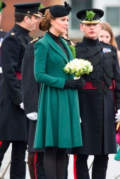 Kate wearing a gorgeous green coat... and look!  A beautiful white hand tied bouquet!