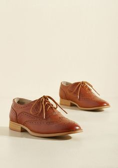 Talking Picture Oxford Flat in Rich Caramel. And now for your feature presentation - these chestnut wingtips! #brown #modcloth