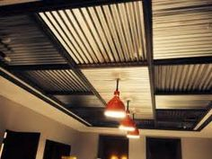 Restored barn lights with corrugated metal ceiling.