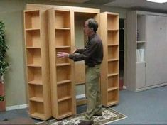 Bookcase Bed Video (no music) I really want a murphy bed. The fact there's a book case with it just makes it 100 times better! Murphy Bed Desk, Murphy Bed Plans, Murphy Door, Murphy-bett Ikea, Bookcase Bed, Revolving Bookcase, Bookcases, Modern Murphy Beds, Bed Wall
