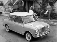 Riley Elf, British Motors Corp. black and white advertisement. White top. Released in 1961 as more luxurious versions of the Mini, both the Wolseley Hornet and the Riley Elf had longer, slightly finned rear wings and larger boots that gave the cars a more traditional three-box design.