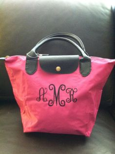 Hot pink foldable tote, perfect for big little gifts or teens for Christmas includes monogramming or sorority letters.. $17.99, via Etsy.