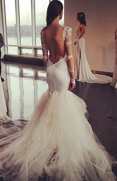 Slightly obsessed with this dress for my 2nd wedding dress! Love the sheer sleeves and sexy back.