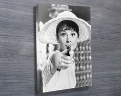 Audrey Hepburn Gun Canvas Print from $26.00. This special pop art features the classic photo of Audrey Hepburn that is captured by Bob Willoughby. As with all art on this site, we offer these prints as stretched canvas prints, framed print, rolled or paper print or wall stickers / decals.  http://www.canvasprintsaustralia.net.au/  #giftsfordad #photostocanvasonline