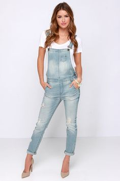 Rock your best digs while dancing to your favorite tunes in the Festival Blues Light Wash Distressed Denim Overalls! These cute denim charmers hold classic details with distressing throughout, adjustable crisscrossing straps above a single-pocket bib, tapered legs, and whiskering on the thighs. Antiqued brass hardware. Belt loops and a five-pocket cut. Unlined. 98% Cotton, 2% Lycra. Machine Wash Cold. Imported.