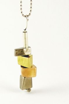 Totem (2), Deborrah Daher.  18k yellow and palladium white gold, 14k red gold, sterling silver.